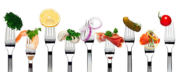Different kinds of cold appetizers on nine forks stock photo