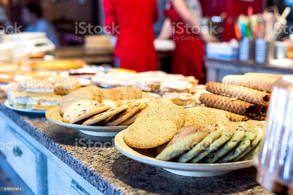 different kinds of homemade cookies on plates stock photo