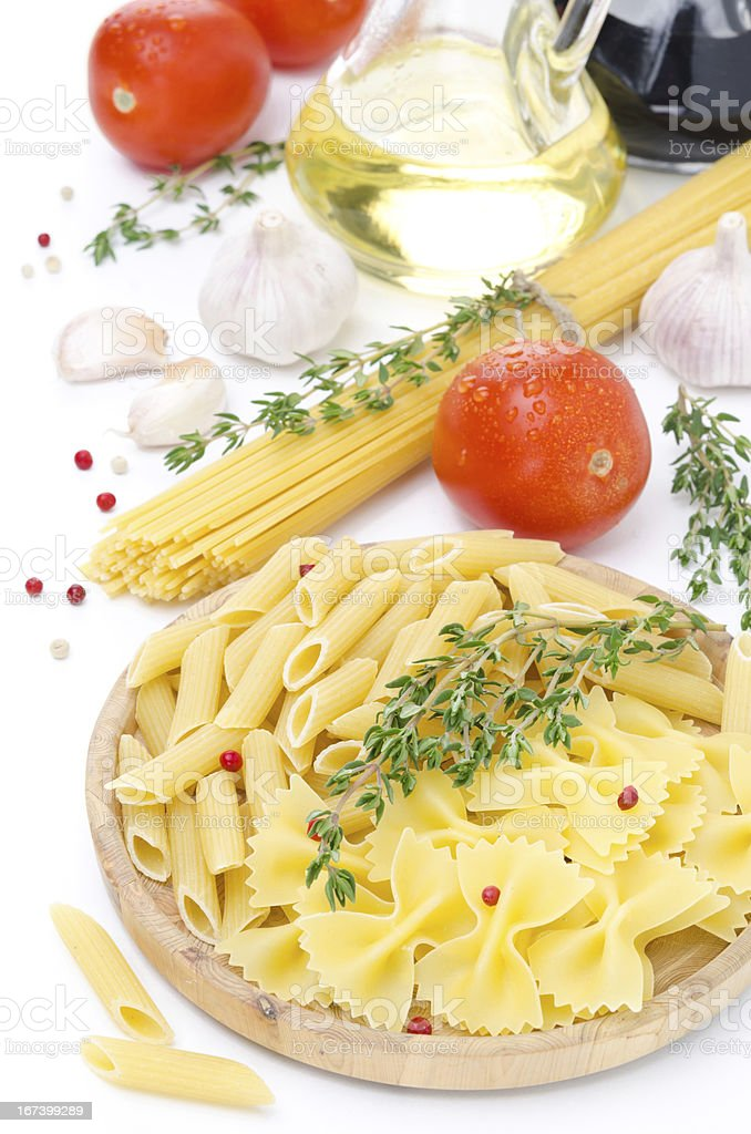 different kinds of Italian pasta, tomatoes and spices royalty-free stock photo