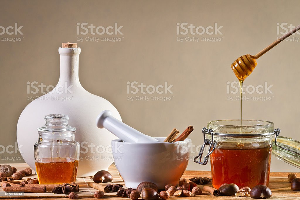 Different kinds of nuts and honey royalty-free stock photo