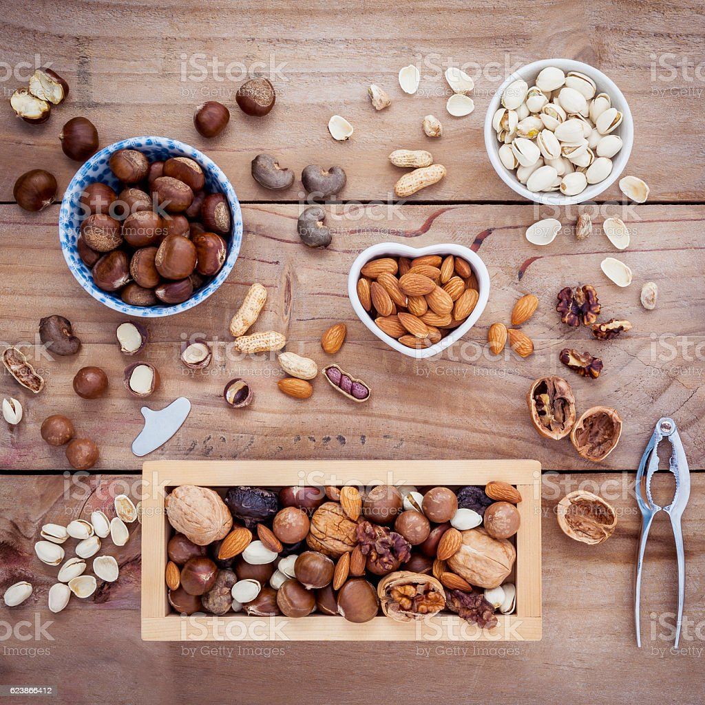 Different kinds of nuts walnuts kernels ,macadamia,hazel nuts, a stock photo