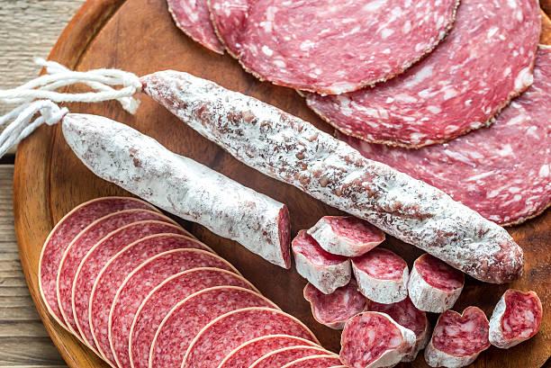 different kinds of salami - fuet sausages fotografías e imágenes de stock