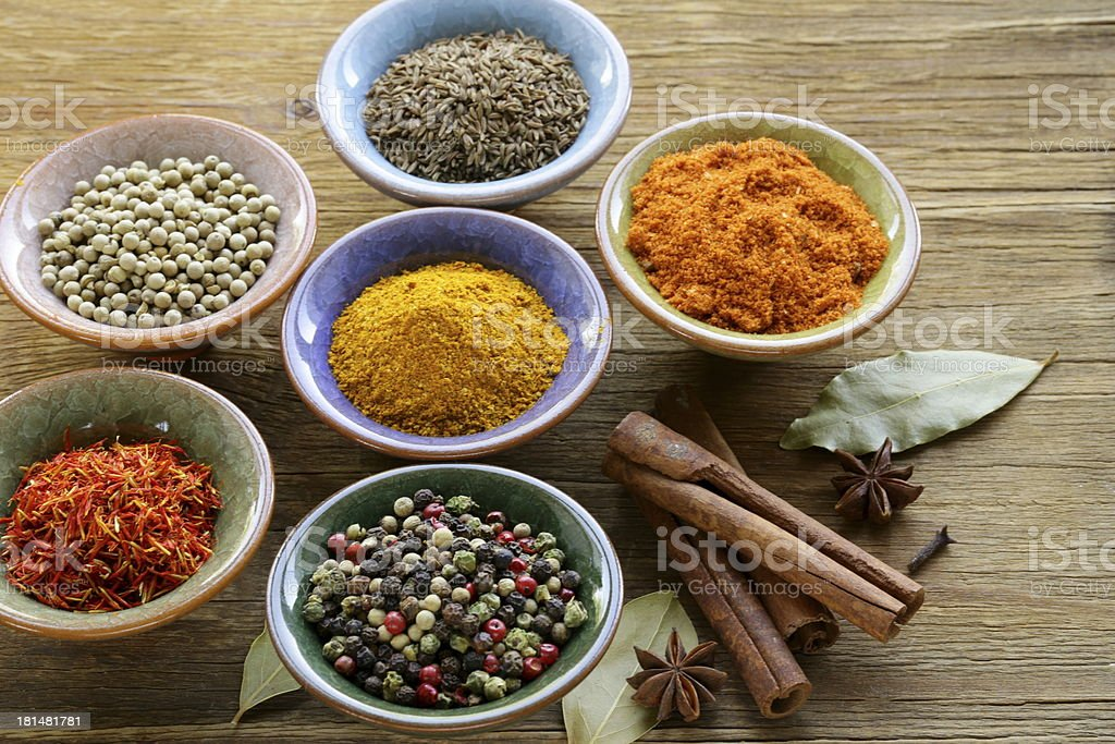 different kinds of spices in ceramic bowls royalty-free stock photo