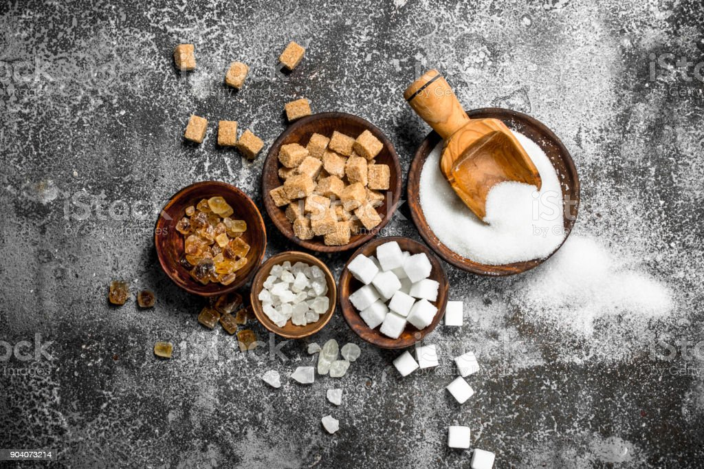Different kinds of sugar in bowls. royalty-free stock photo