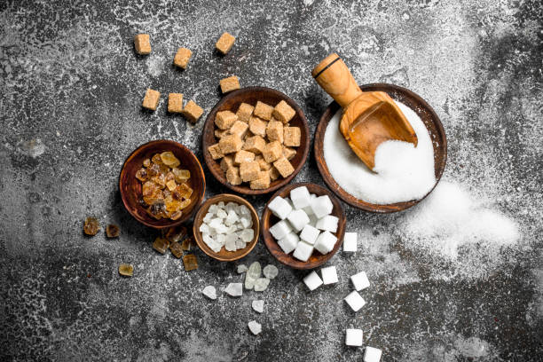 Different kinds of sugar in bowls. stock photo