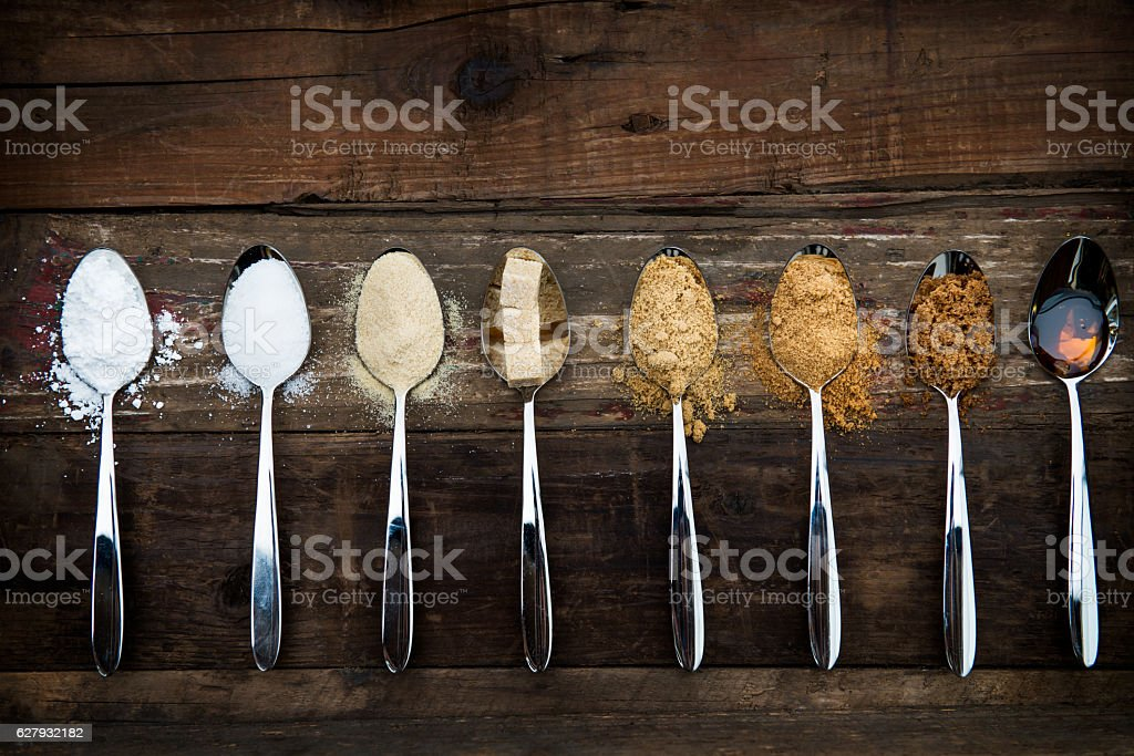 Different Kinds of Sugar in the Spoons stock photo