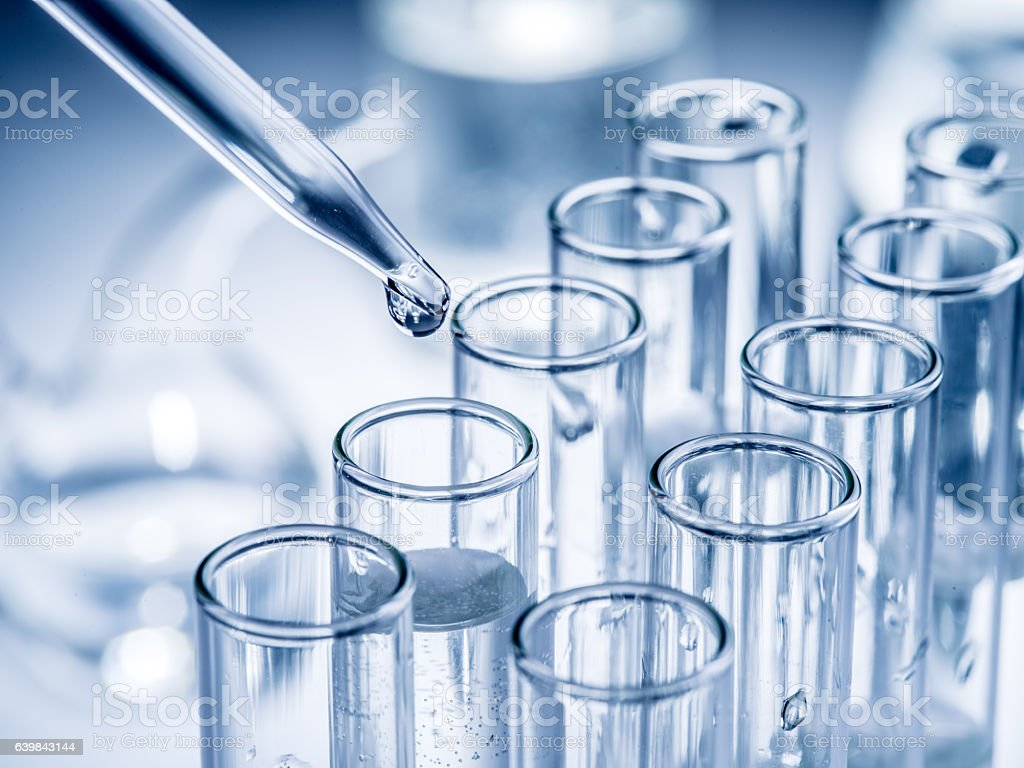 Different laboratory beakers and glassware. stock photo