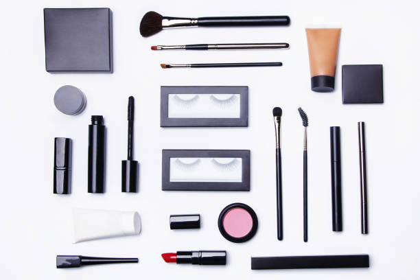 Different makeup objects and cosmetics stock photo