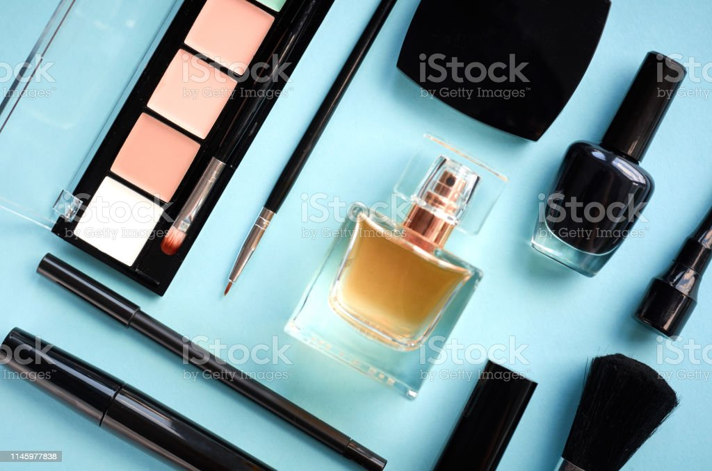 Different makeup products composition on blue background, flat lay...