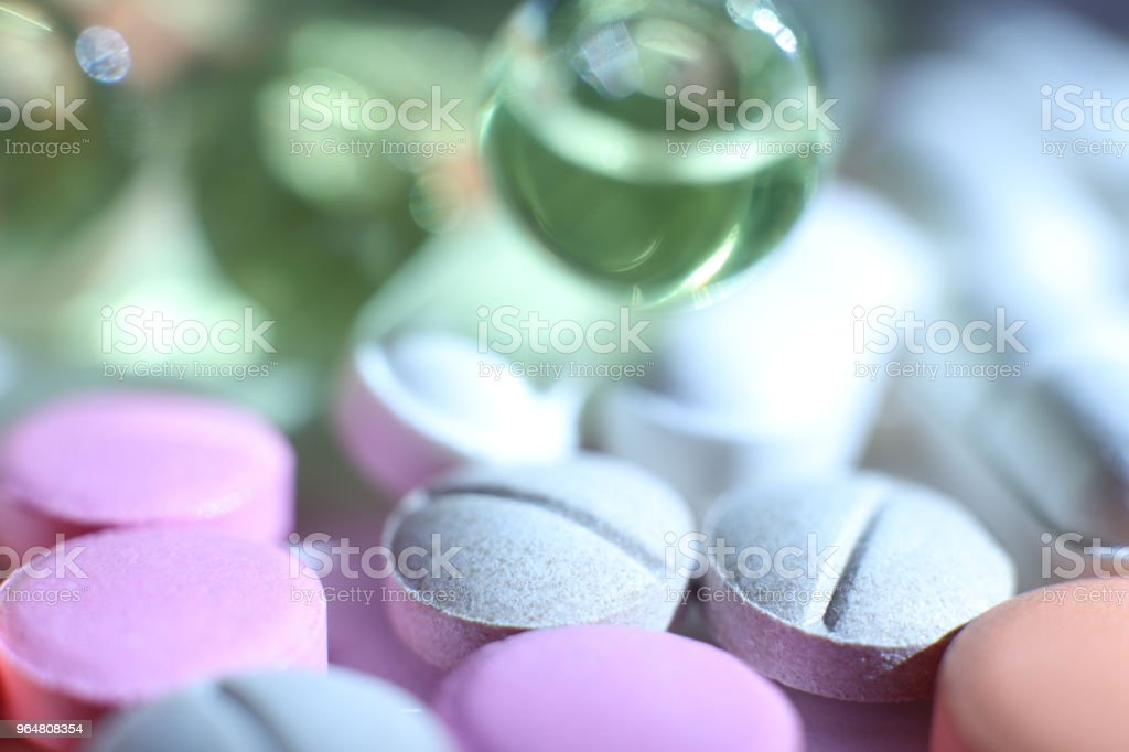 Different Medicine Tablets Stuff. Pharmacy Background. Macro Closeup. royalty-free stock photo