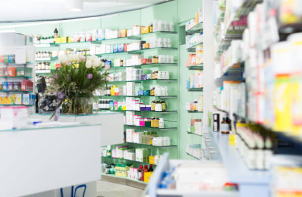 Different medicines on the shelves in the pharmaceutical  store stock photo