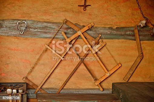 istock Different metal worker tools on wooden table 629967108