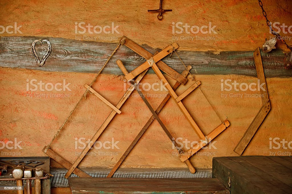 Different metal worker tools on wooden table stock photo