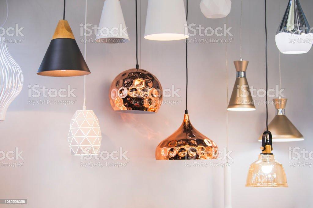 Different modern streamlined mirror copper chandeliers. Bubble metal copper shade pendant - Стоковые фото Без людей роялти-фри