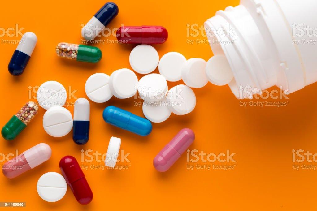 Different multicolored pills and medicine capsules stock photo