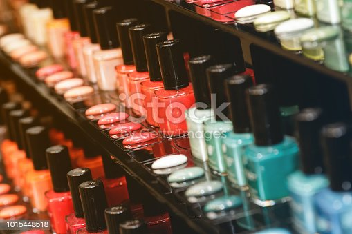 Different nail polishes in the shop