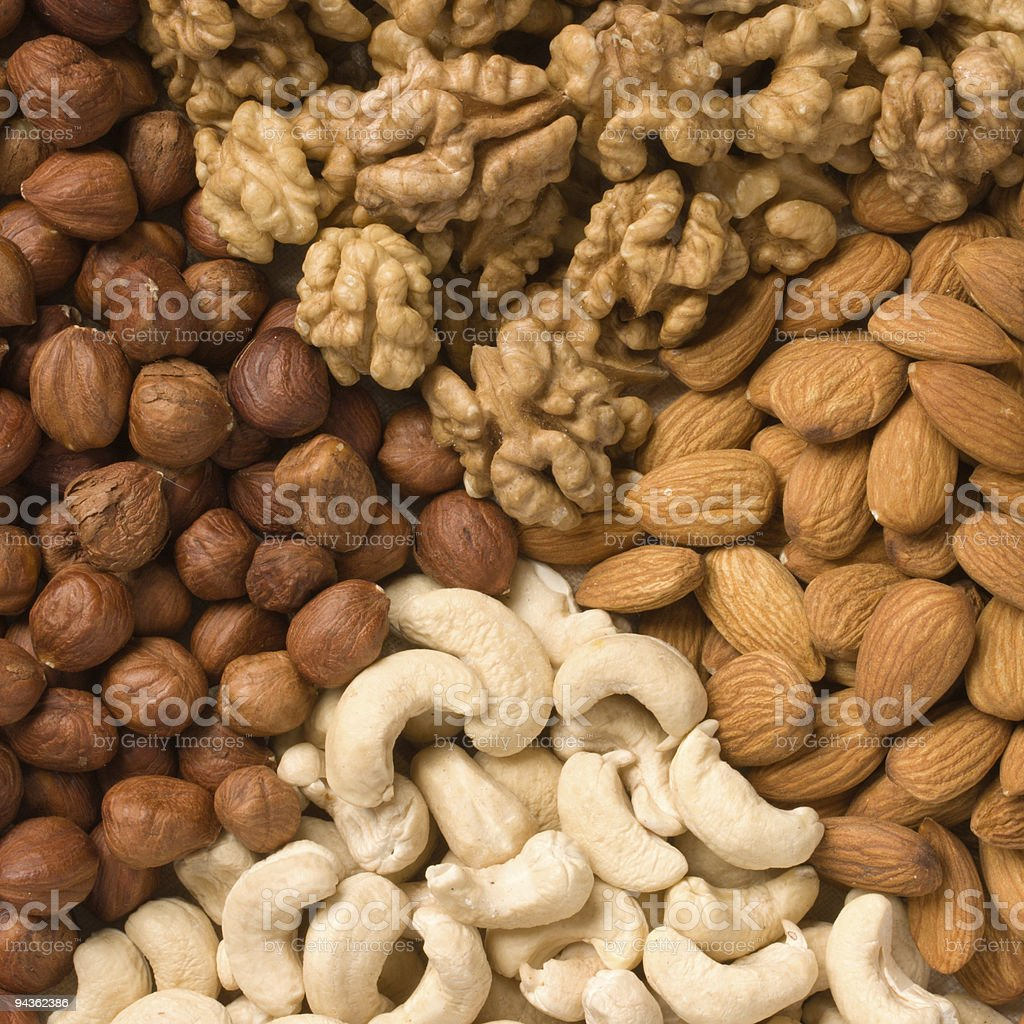 Different  nuts (almonds, cashews, walnuts and filbers) close up stock photo