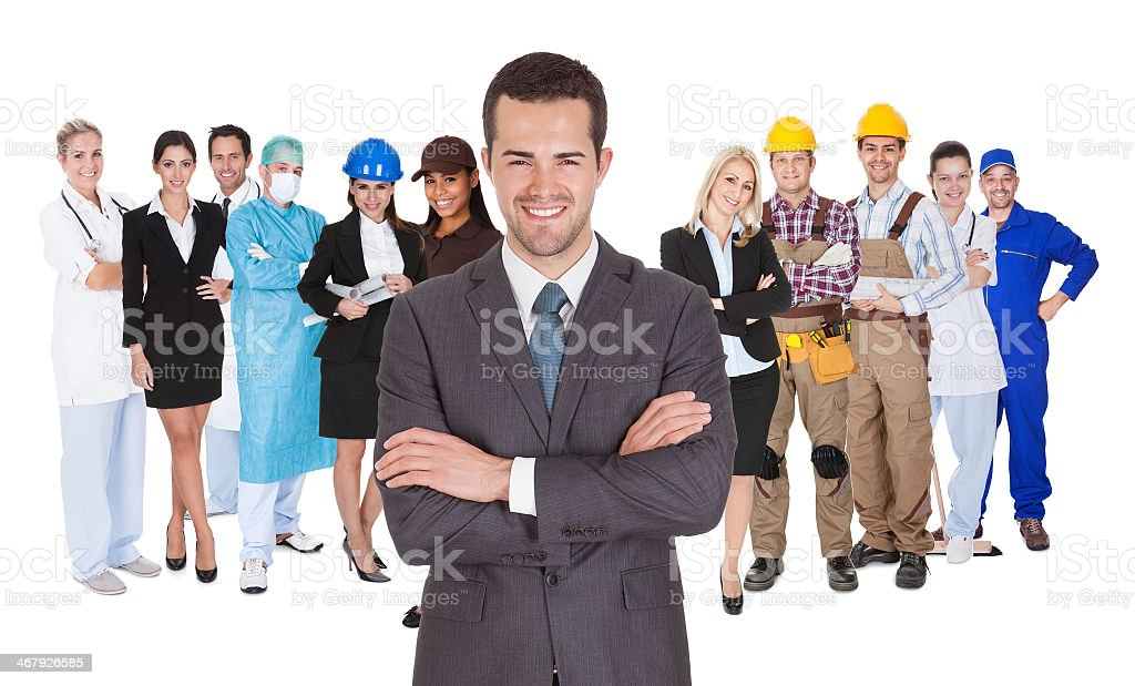 Different occupations behind one businessman stock photo