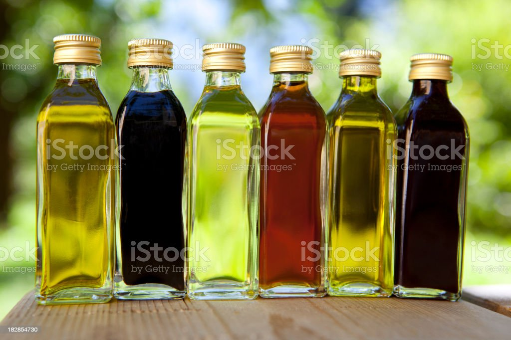Different oils and vinegars stock photo