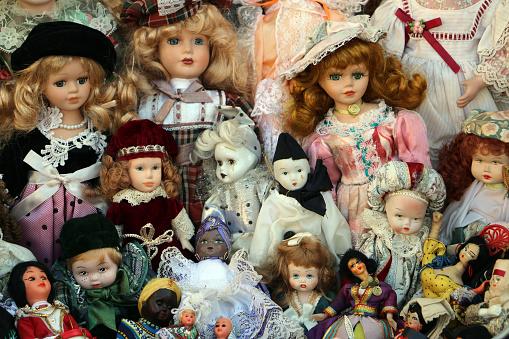 Different old dolls together
