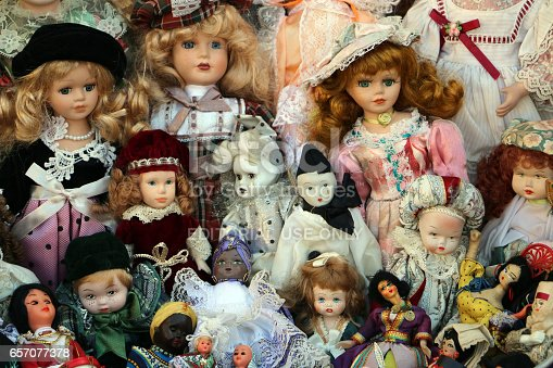 Sanremo, Italy, March 12, 2017.,  Bunch of different old dolls on sale at open market of old things