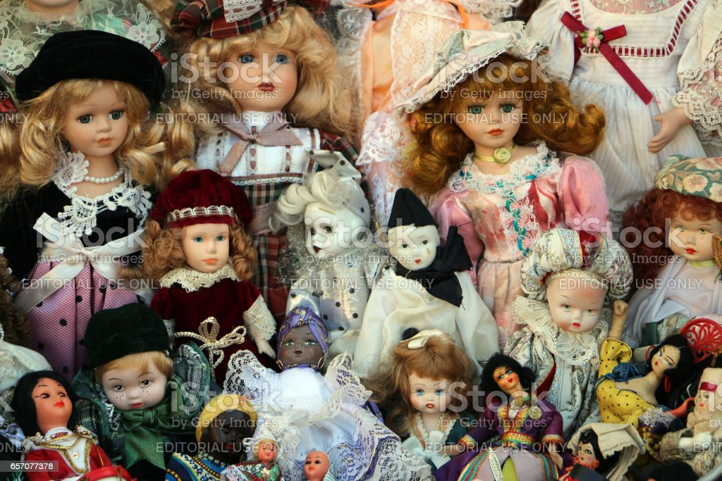 Different old dolls together stock photo