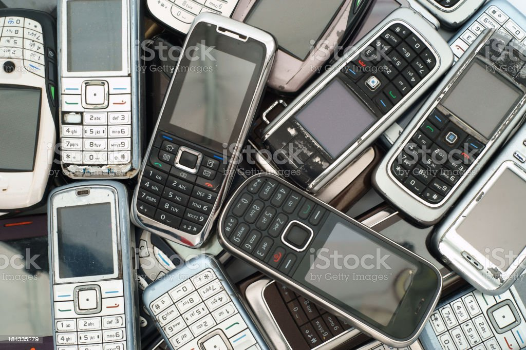 Different old phones piled and stacked on top of each other royalty-free stock photo