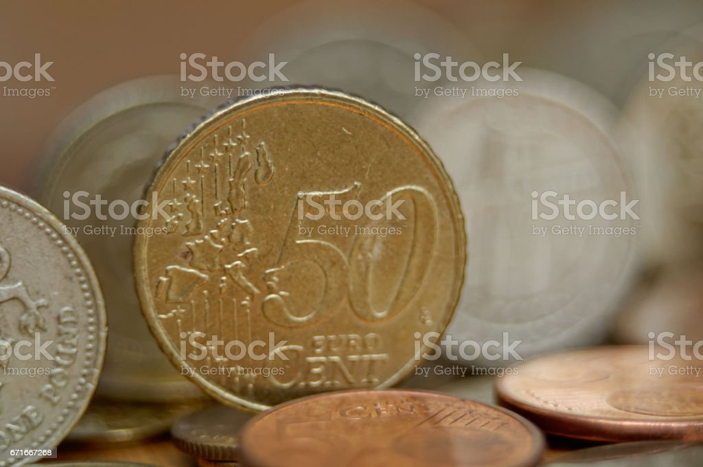 Different one-pound coins and 50 eurocent stock photo