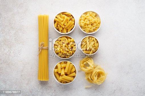 istock Different pasta varieties on light gray background. 1169676977
