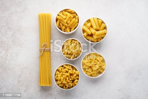 istock Different pasta varieties on light gray background. 1169677756