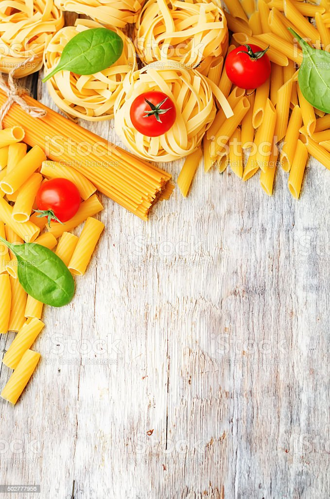 different pasta with tomatoes and spinach stock photo