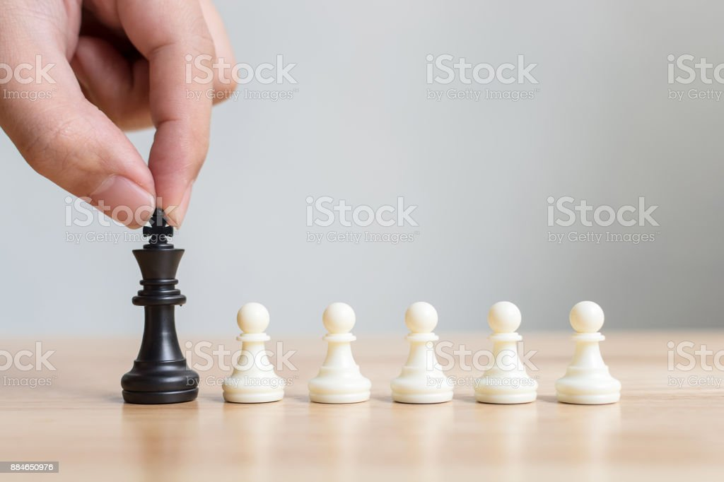 Different pawn chess board game, Leadership business, Unique, Think different, Individual and standing out from the crowd concept stock photo