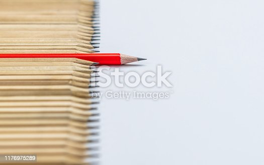 istock Different pencil standout show leadership concept. 1176975289