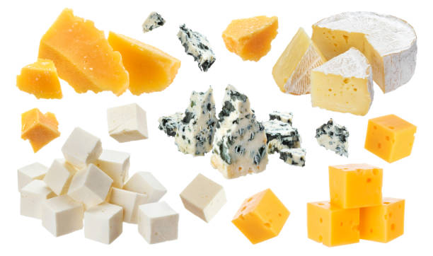 Different pieces of cheese. Cheddar, parmesan, emmental, blu cheese, camembert, feta isolated on white background Different pieces of cheese. Cheddar, parmesan, emmental, blu cheese, camembert, feta isolated on white background with clipping path cheddar cheese stock pictures, royalty-free photos & images