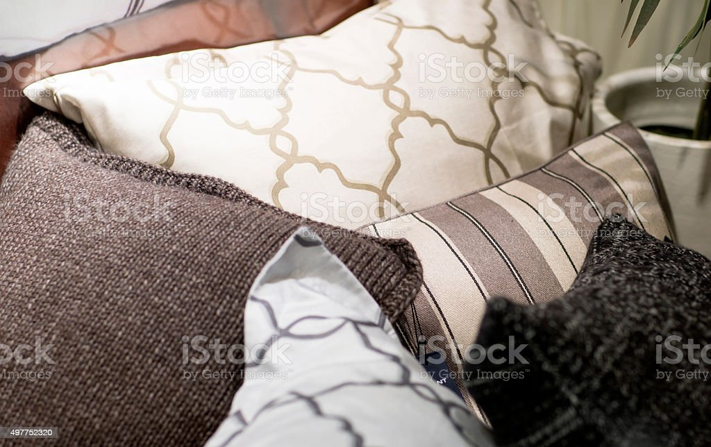 Different pillows. Pillowcases sewn from different fabrics. 2015 Stock Photo