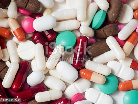 istock Different pills on a white background. The medicine. 1126081528