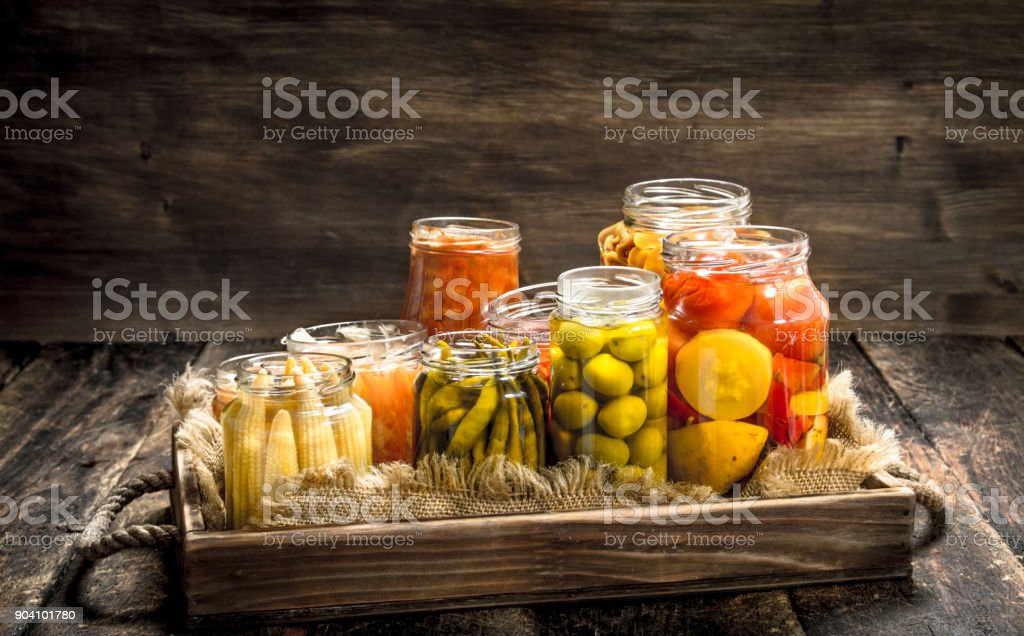 Different preserved vegetables from vegetables and mushrooms in glass jars. stock photo