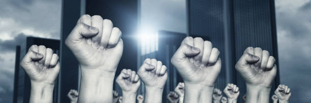 different raising up left fists stock photo