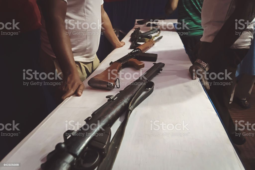 different rifles on the counter in the gun shop. stock photo
