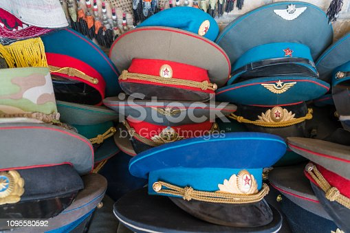 Bunch of old Russian army officers caps on flea market.