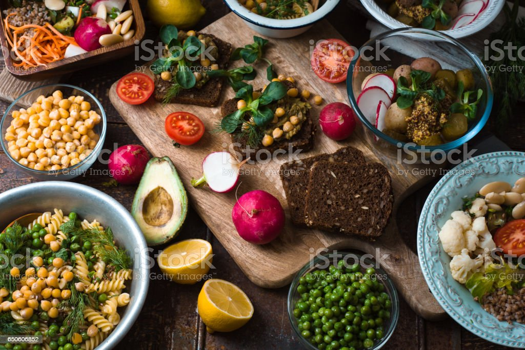 Different salad and snack on the wooden table horizontal stock photo