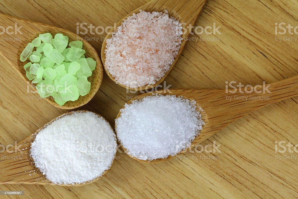 Different Salt in a wooden spoon stock photo