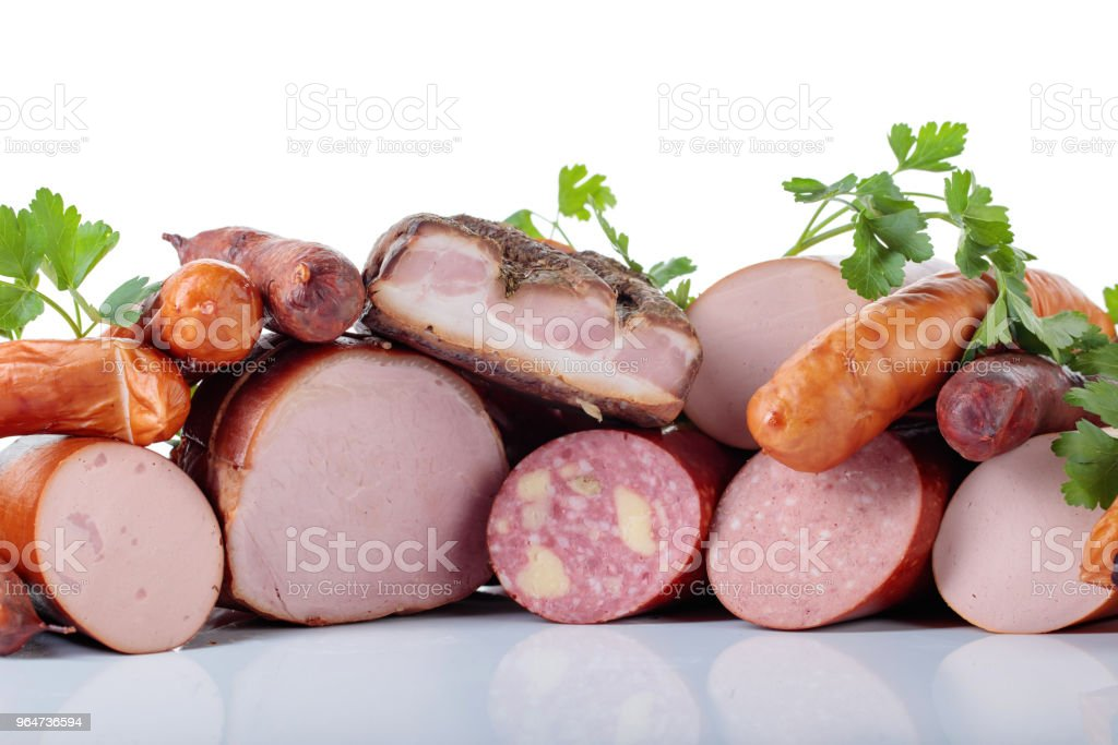 Different sausages and smoked meats isolated on white . royalty-free stock photo