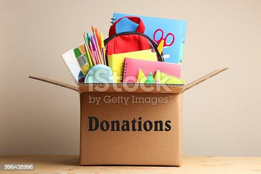 istock Different school supplies in a cardboard box 996438996