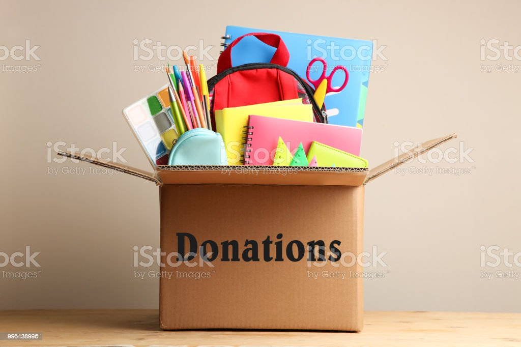 Different school supplies in a cardboard box stock photo
