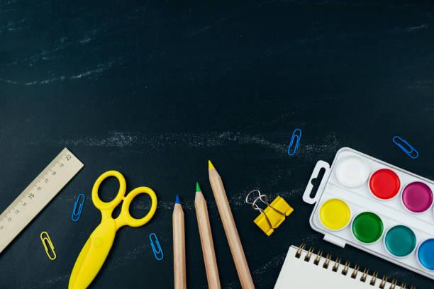 Different school supplies on blackboard background picture id1158538276?b=1&k=6&m=1158538276&s=612x612&w=0&h=hcnhjdrtj9tils9qlqxyaqlfsdu44vzvjg7htzf14x0=