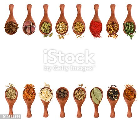 istock Different seasonings and spices in wooden spoons 912611144
