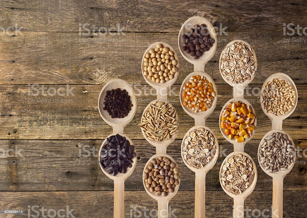 Different Seeds on Wooden Spoons stock photo