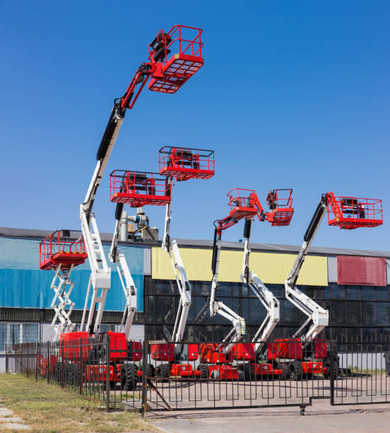Different self propelled articulated boom lifts and one scissor lift stock photo