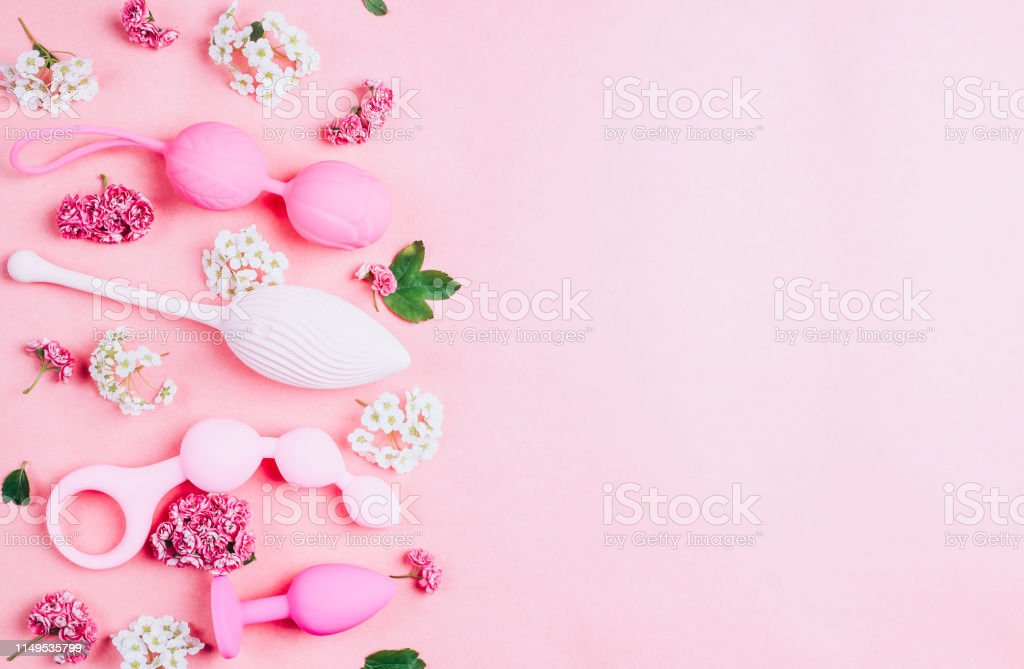 Different sex toys set on a pink background. Different sex toys set on a pink background. Empty space for your text. Sex shop advertising. Top view. Springtime Anus Stock Photo